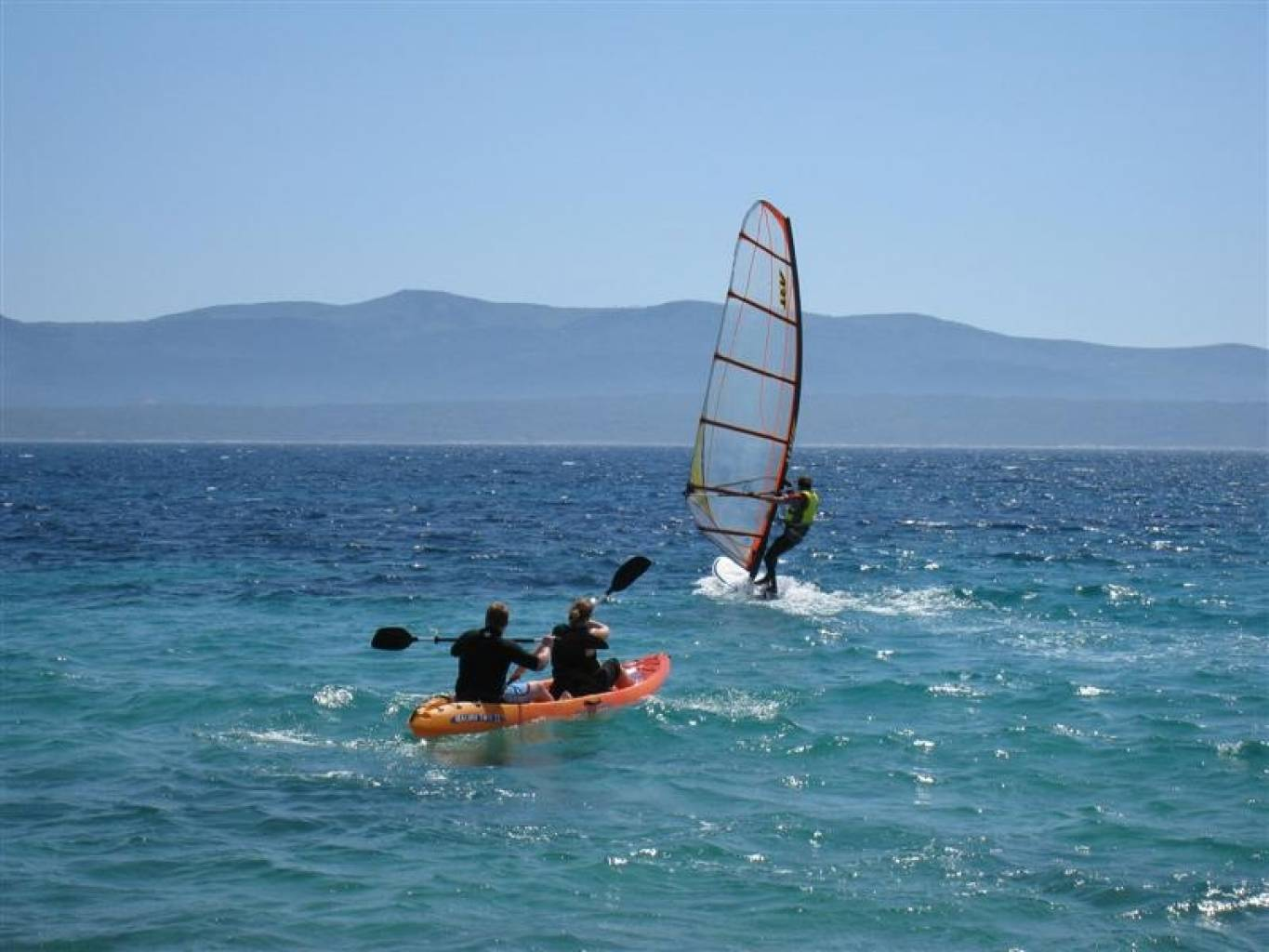 Sea kayaking and windsurfing